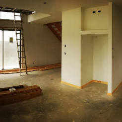 This is taken from the kitchen space. Above the doors on the left of the photo is a void with three long windows above it to bring that natural light in with a 2 storey house right on the boundary beside this new home.
