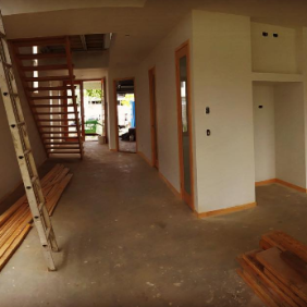 This photo was taken looking from the dining area back up the hallway to the front doors. Peter at Small Lot Homes has some really great designs to make even the narrowest of blocks feel wide and open.