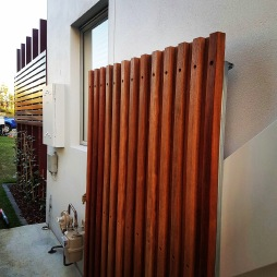 To create this gate we wrapped the steel frame with kwila in different thicknesses to give it a layered look.